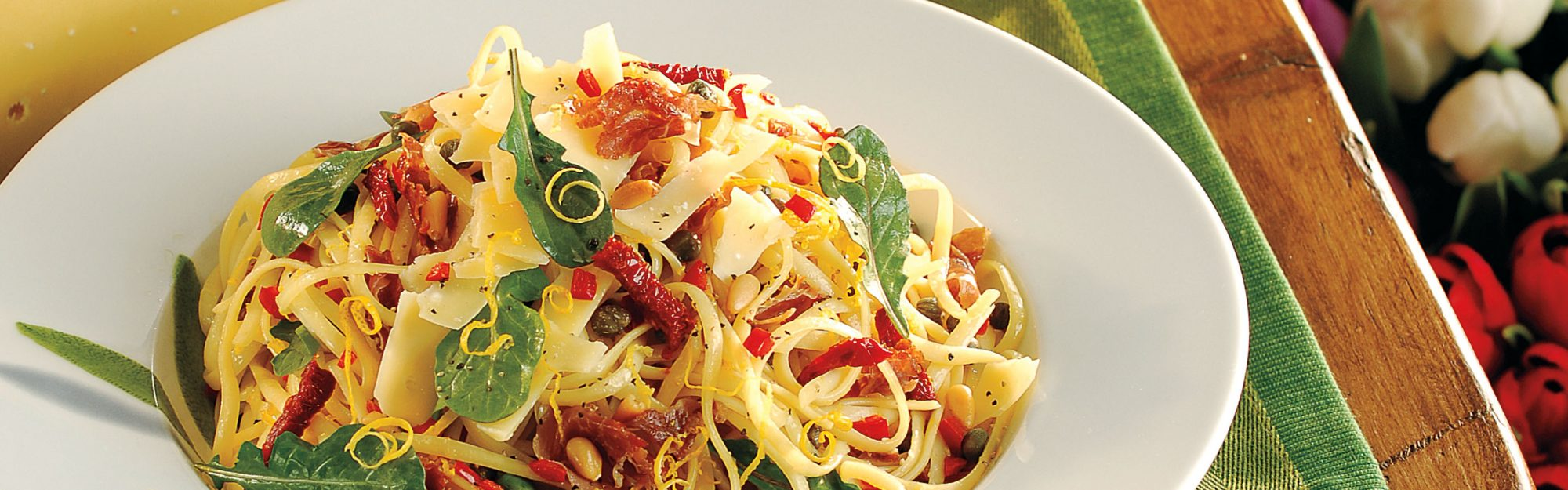 Linguine with arugula proscuitto gouda cheese