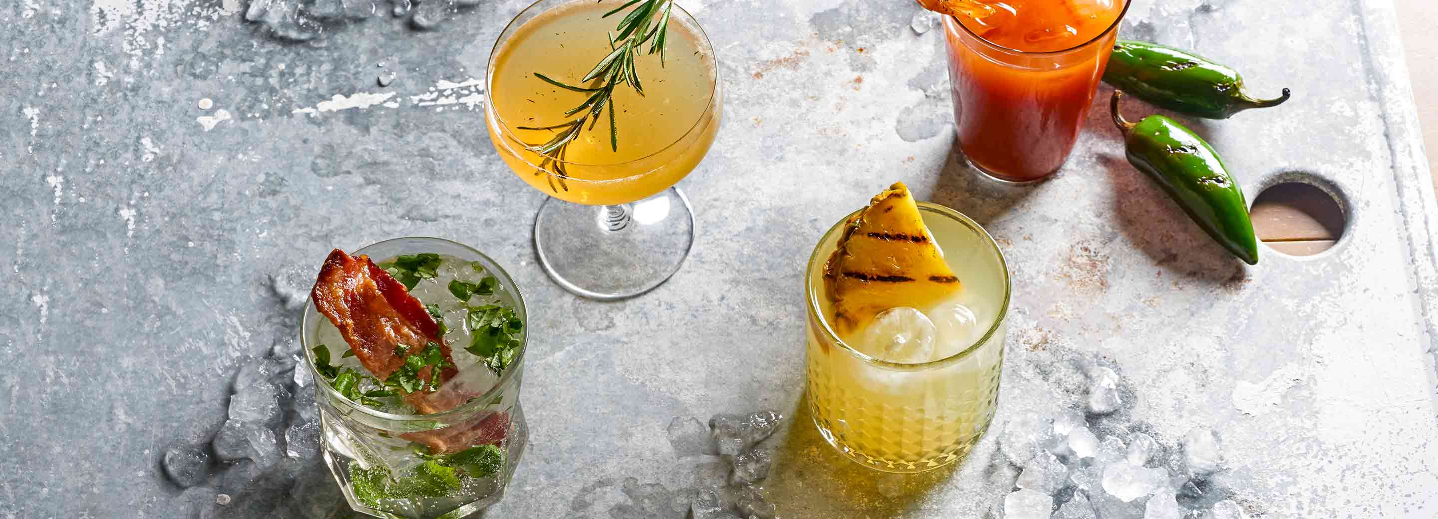 Four cocktails made from grilled ingredients
