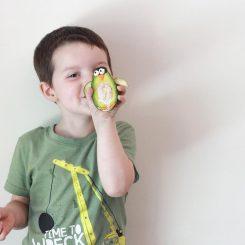 kid holding avocado penguin